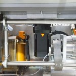 An AKM servo motor from KOLLMORGEN is used to drive the vertical form fill seal machine's feeder belt.