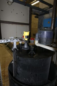 Radars are mounted above each of the smaller acid and caustic day tanks measuring the liquid level from outside the vessel, for ultimate safety
