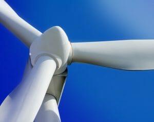 White Wind Turbine on Blue Sky Closeup